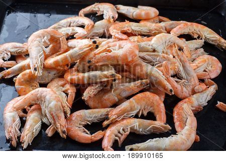 A Lot Of Shrimp On A Black Background. Good Selection Of Raw Shrimps For Dinner On Stone Plate. Food