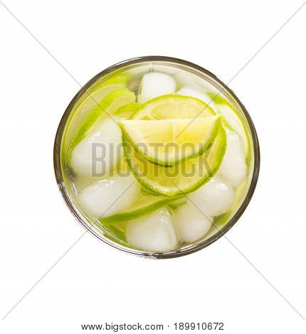 refreshing lemonade with green lemon and ice isolated on white background close-up top view