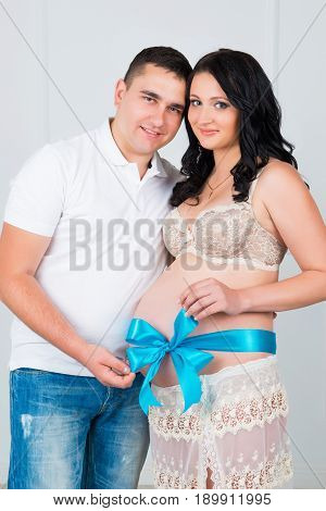 9 months. Pregnant couple awaiting the birth of a son