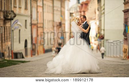 Magnificent Wedding Couple Stands On The Empty Street