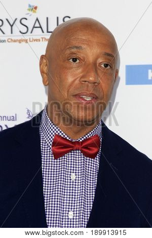 LOS ANGELES - JUN 3:  Russell Simmons at the 16th Annual Chrysalis Butterfly Ball at the Private Estate on June 3, 2017 in Los Angeles, CA