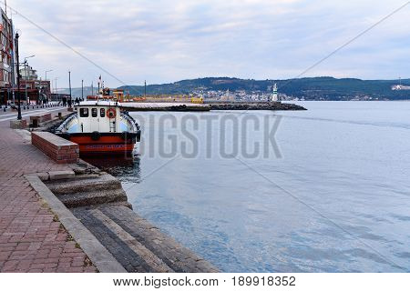 View Of Embankment And Lighthouse In The Morning. Canakkale, Turkey