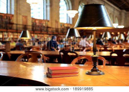 Books on the table in the reading room in the library