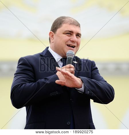 Orel Russia - August 03 2016: Eagle statue opening ceremony. Vadim Potomsky Orel city governor speaking in microphone square
