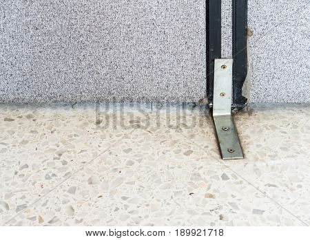 Metal clip lock of the old partition base in the home office.Copy space