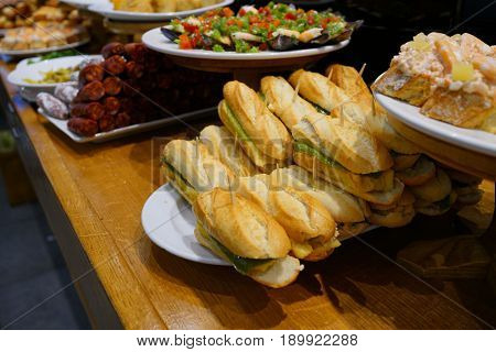 Spanish fingerfood and tapas set on bar counter