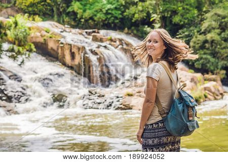 Young Woman On The Background Of Beautiful Camly Waterfall In Da Lat City