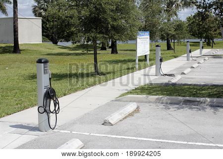 Fort Lauderdale FL USA - May 16 2017: Several ChargePoint electronic vehicle charging stations. 4 EV charging stations in a public parking lot on a sunny day