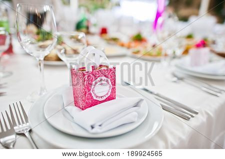 Small Pink Box With Candies At Table On Dish Of Wedding Guest.