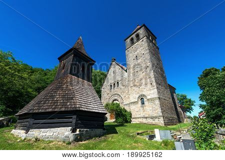 The Church of the Assumption of the Virgin Mary - kostel Nanebevzeti Panny Marie - and a wooden belfry in the village of Vysker in the Bohemian Paradise.