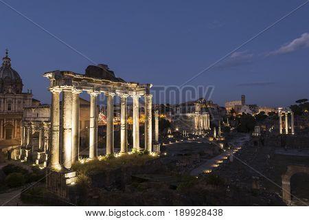 Ancient ruins at forum romanum in Rome at dusk Italy