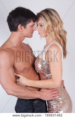 The attractive couple is in a loving embrace.