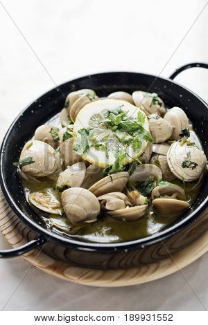 portuguese stewed clams in garlic herb and white wine seafood sauce