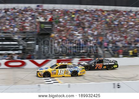 June 04, 2017 - Dover, DE, USA: Kyle Busch (18) battles for position during the AAA 400 Drive for Autism at Dover International Speedway in Dover, DE.