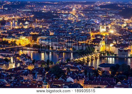 Prague at twilight blue hour, view of Charles Bridge on Vltava with Mala Strana and Old Town.