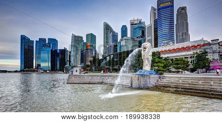SINGAPORE, 2 June 2017 -The Merlion fountain and Singapore skyline.  The Merlion is an imaginary creature with a head of a lion and the body of a fish and is often seen as a symbol of Singapore.