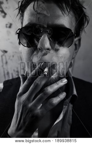 Smoking Man Dressed In Sunglasses