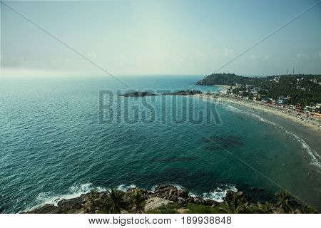 Sandy beach and blue sea view from above. India Thiruvananthapuram