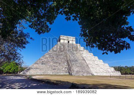 Pyramid known as El Castillo in the ancient Mayan ruins in Chichen Itza Mexico