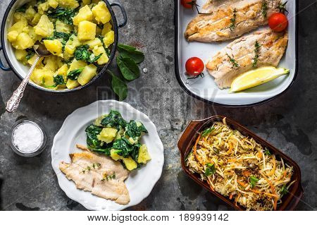Griled Fish Fillet With Potato And Salad