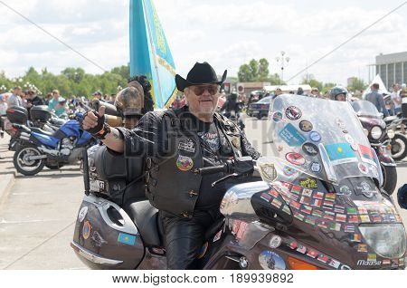 Brest, Belarus - May 27, 2017: Bikers on their motorcycles in special clothes ride a collar on the outskirts of the city of Brest at the annual international festival of bikers on May 27.