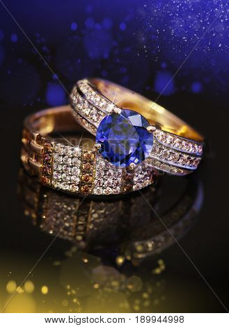 Elegant jewelry two rings with Sapphire and diamonds on black background