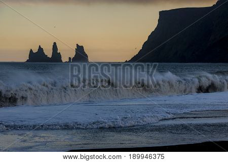 Reynisdrangar rock formations and the mount Reynisfjall. Black beach in Vik southern Iceland