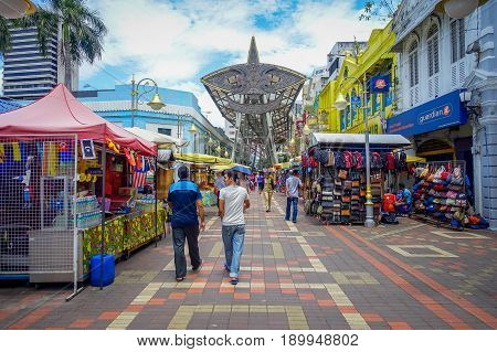 Kuala Lumpur, Malaysia - March 9, 2017: Petaling street market, in the heart of the Chinatown of the city is a popular area for shopping and tourism