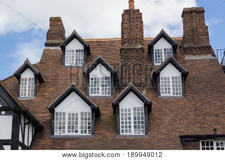 Ruthin Wales UK - June 4 2017: The Seven Eyes of Ruthin on the Myddleton Arms on Saint Peters Square a rare and unusual multi dormer set of windows built circa 16th century