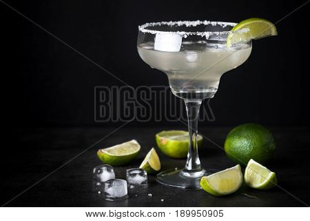 Margarita cocktail on black background. With space for your text