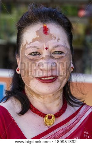 POKHARA NEPAL - OCTOBER 01 2016 : Portrait old woman with a pigmented spots on the face in the street. Pokhara Nepal