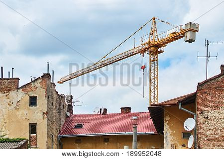 Building with crane in the old city neighbourhood