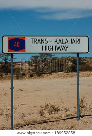 highway marker sign indicating the edge of the Kalahari desert highway in Namibia