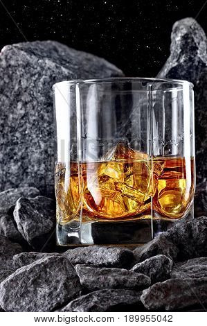 Glass Of Whiskey And Ice.creative Photo Glass Of Whiskey In Stone Mountain.copy Space.advertising Sh