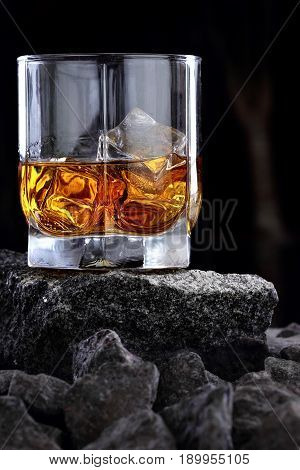 Glass Of Whiskey And Ice.creative Photo Glass Of Whiskey On Stone .copy Space.advertising Shot