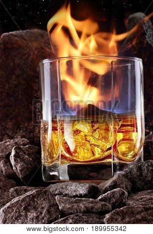 Glass Of Whiskey With Fire And And Ice Inside.creative Photo Glass Of Whiskey In Stone Mountain With