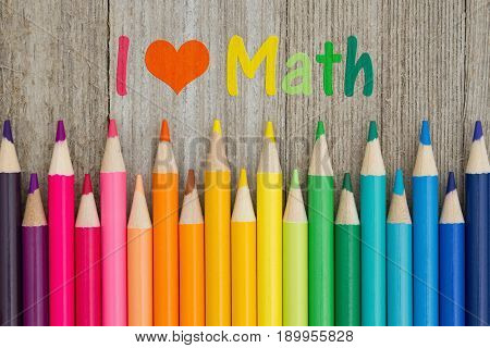 I love math text with colorful pencil crayons on a weathered wood