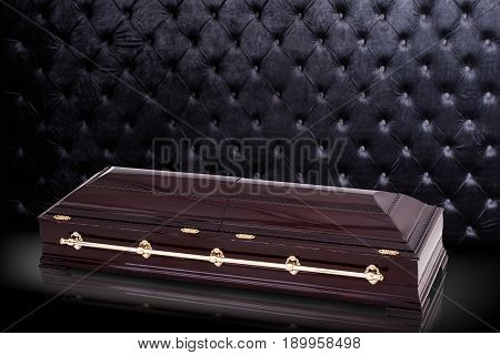 closed wooden brown sarcophagus isolated on gray luxury background. casket, coffin on royal background. Ritual objects for burial. Conduct of the deceased on his last journey. Surrender body dust of the earth. Christian funeral ritual