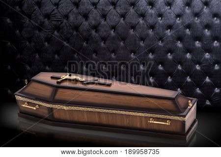 closed wooden brown coffin with Church cross isolated on gray luxury background. casket on royal background. Ritual objects for burial. Surrender body dust of the earth. Christian funeral ritual
