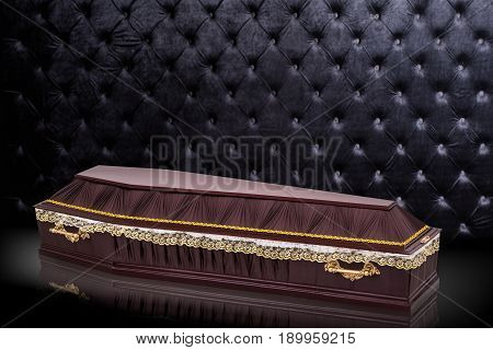 closed wooden brown coffin covered with cloth isolated on gray luxury background. casket with shadow on royal background. Ritual objects for burial. Surrender body dust of the earth. Christian funeral ritual