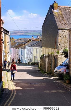 Padstow, Cornwall, Uk - April 6Th 2017: Cross Street, A Quaint Narrow Road With Sea View In The Pict