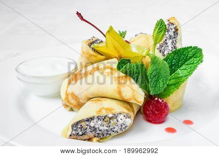 Delicious Dessert. Pancakes With Cottage Cheese And Poppy Seeds Inside, Oblong, Decorated With Berri