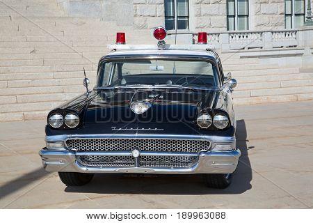 Salt Lake City, Utah, USA - October 8, 2016. Historical police car in front of the Utah State Capitol.