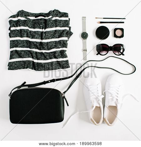 Trendy fashion black styled woman clothes and accessories collection on white background. Flat lay top view.