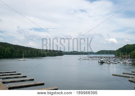 Scenic view of pier, boats docked, and river.  Tributary of Tennessee River at Joe Wheeler State Park, Alabama