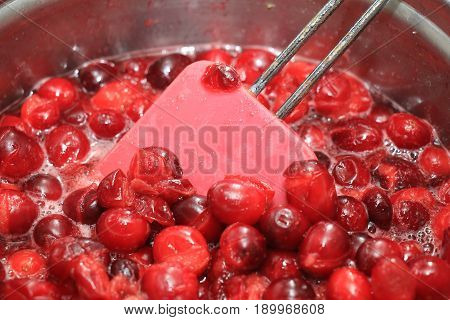 Preparing homemade cranberry sauce for thanksgiving or christmas