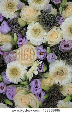 Purple and white wedding flowers table centerpiece for a wedding