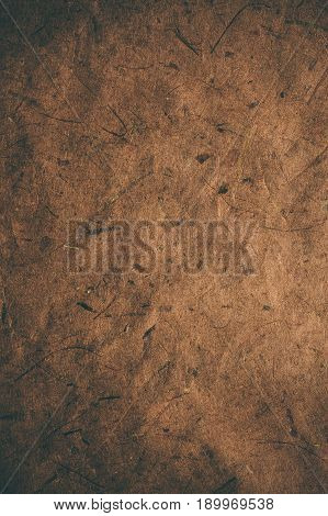 Brown rough vintage paper. Abstract background and texture for designers. Old vintage recycled paper. Dark rough vintage paper background. Brown rough paper in vintage style.