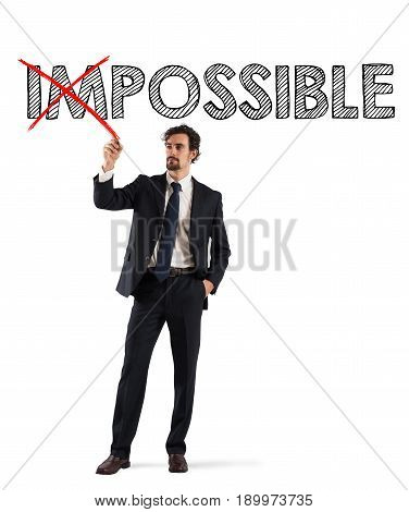 Concept of change impossible to possible with businessman with a red pen