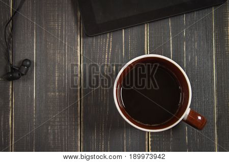 Electronic Devices And Elements On A Dark Wooden Background. Place For The Text. A Concept For Fathe